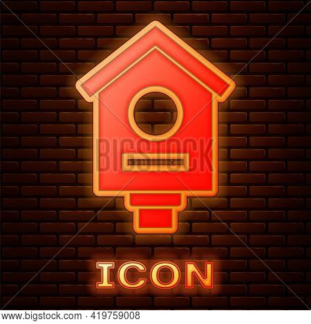 Glowing Neon Bird House Icon Isolated On Brick Wall Background. Nesting Box Birdhouse, Homemade Buil