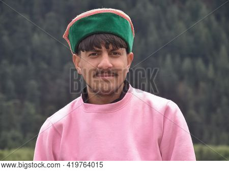 Portrait Of A Handsome Young Guy Wearing Pink Color Sweatshirt And Himachali Topi (himachali Traditi