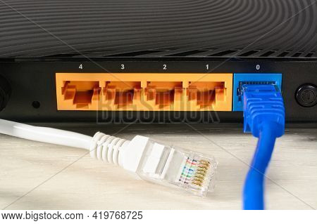 Home Wi-fi Router For Internet Connection With Two Patch Cords With Rj45. Concept Home Network, Clos