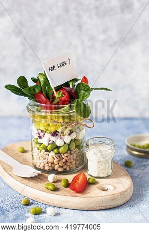 Homemade barley groats salad with goat cheese in a jar