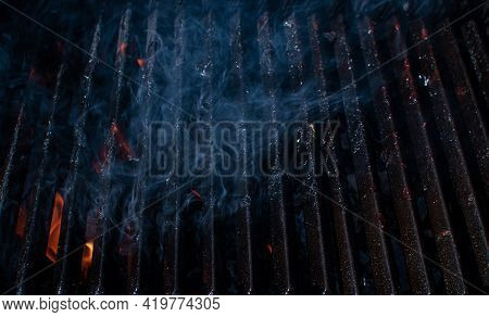 Empty Flaming Bbq Charcoal Grill With Smoke Or Barbeque With Black Iron Grate For Cooking Outdoor Me
