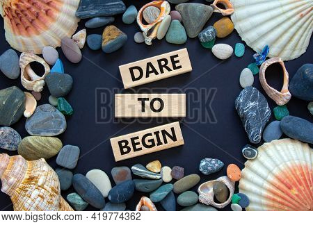 Dare To Begin Symbol. Wooden Blocks With Words 'dare To Begin'. Beautiful Black Background, Seashell
