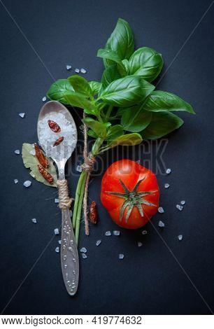 Aromatic seasoning on black background