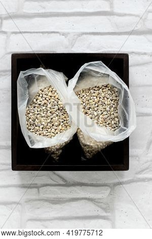 Barley groats in plastic bags