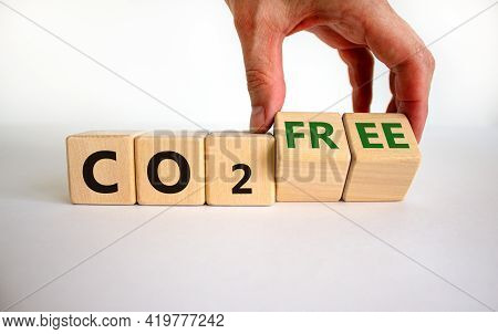 Co2 Free Symbol. Businessman Turns Cubes, Changes Concept Words 'co2' To 'co2 Free'. Beautiful White