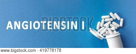 The Word Angiotensin Ii Is Written Near Pills On A Light Blue Background. Medical, Health And Happin