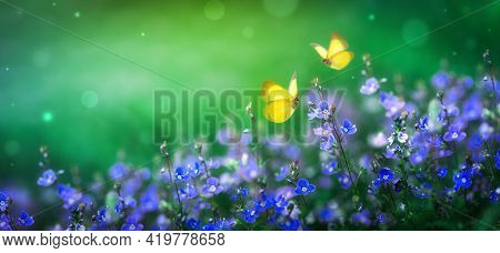 Beautiful Summer Nature Scene With Magic Blue Flowers And Flying Butterflies On Green Background. Wi