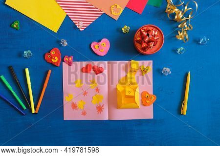 Homemade Greeting Card. Flowers And Hearts From Paper And Plasticine As Gift For Mothers Day, Birthd