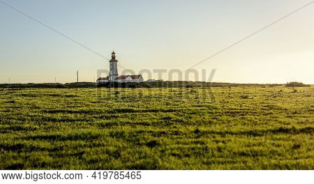 Old Lighthouse On The Background Of Blue Sky With Clouds. Cabo , Portugal