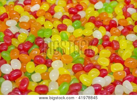 multicolored gelatin candy in the form of peas as a background for greeting card poster