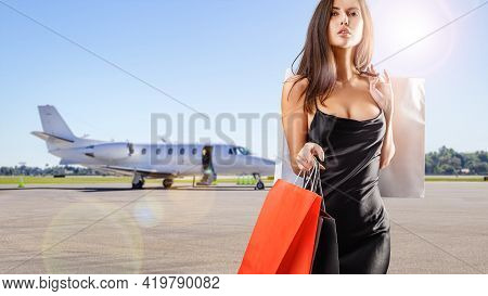 Young Beauty With Shopping Bags Coming From A Privat Jet