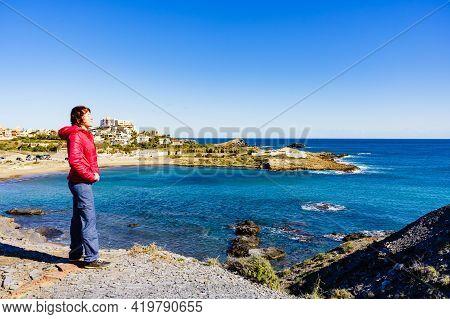 Tourist Woman Relaxing On Spanish Seashore. Mediterranean Sea Coast Landscape, Coastline In Murcia R