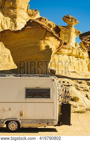 Camper Car On Parking Area At Eroded Yellow Sandstone Formations, Enchanted City Of Bolnuevo, Murcia