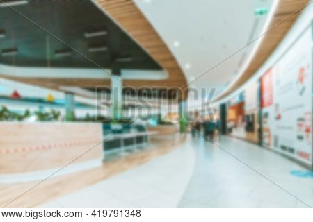 Shopping Mall People Blurred Background. People Shopping In Modern Commercial Mall Center. Interior