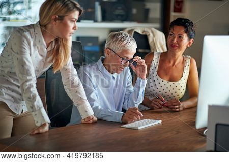 Group of female colleagues have a consultation about a job in a working atmosphere at the workplace. Business, office, job