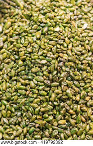 Heap Of Peeled And Fresh Green Pistachios For Background (selective Focus, Vertical Photo)