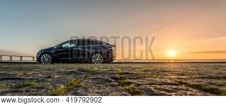 Lisbon, Portugal - January 13 2017 : Dark Blue Tesla Model X On Empty Square, Near Vasco Da Gama Bri