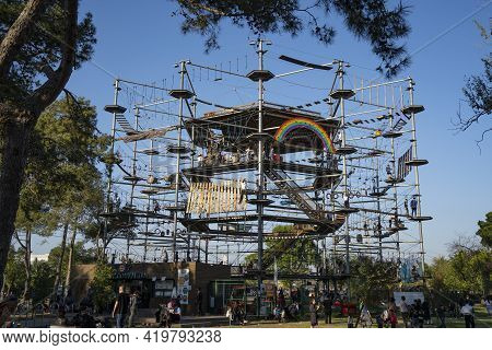 Tel Aviv, Israel - March 31st, 2021: A Crowd Around A Rope Adventure Attraction In A Park In Tel Avi