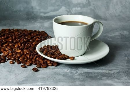 Hot Black Coffee For Morning Beverage Menu In White Ceramic Cup With Coffee Beans.