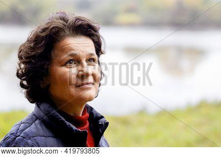 Ukraine, Khmelnytsky Region. November 2020. An Elderly Woman In Nature With A Slight Smile Feels Hap