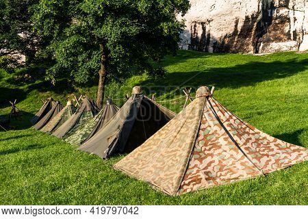 Reconstruction Of A World War Ii Military Camp During A Reenactment Event.  German Military Tents Fr