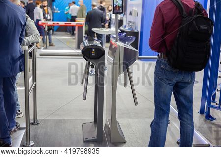 Moscow, Russia - 14 April 2021 : People Are Looking At Various Turnstiles, Frames And Other Equipmen