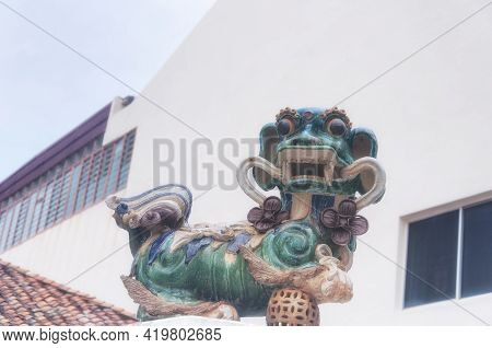 A Kylin Statue Within The Xiang Lin Si Buddhist Temple In Melaka Malaysia With A Blurred White Backg