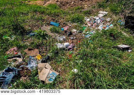 Miercurea Ciuc, Romania- 08 May 2021: Human Trash Near Roadside, Conceptual Image Of Human Negligenc