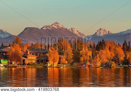 Anchorage, Alaska, Usa - 30 September 2016: Warm Colors Of Sunset At Spenard Lake In Anchorage. Smal