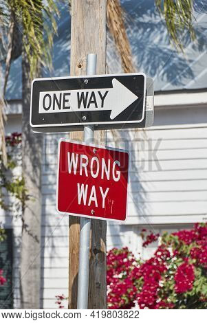 Confusing Street Signs One Way And Wrong Way Different Directions