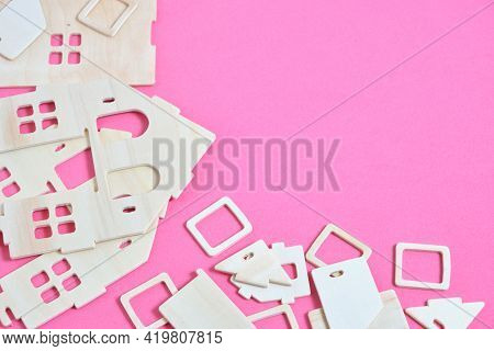 Details Of Constructor Of Prefabricated Wooden Orphanage On Pink Background