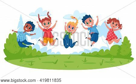 Kids Jumping On Meadow. Happy Children Having Fun Outside In Summer. Boys And Girls Playing Together