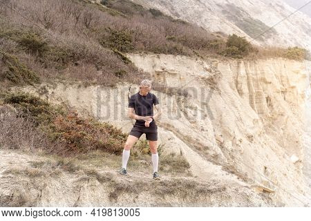 Runner Standing On Mountain, Looking On Watch