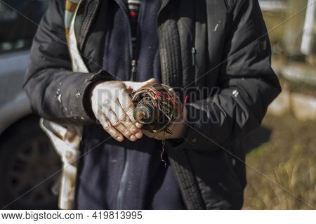 Hands Of A Metal Scrap Collector With A Piece Of Electric Engine, Shallow Dof