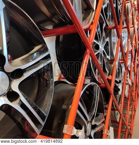 Automotive Alloy Aluminum Alloy Wheels On The Stand Of The Car Dealership