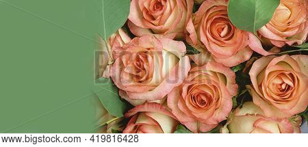 Banner With A Beautiful Bouquet Of Roses, Top View. Creative Concept.