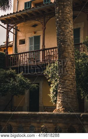 Old Wooden Balcony Of Traditional House In Tiny Mediterranean Village On Mallorca, Balearic Island,