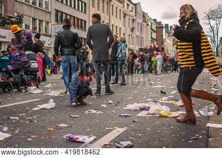 Aachen, Germany - February 12, 2018: The Aachen Rose Monday Procession In The Carnival. Trash On Str