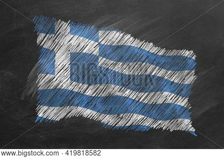 National Flag Of Greece Hand Drawn With Chalk On Blackboard. Flag Waving In Wind. One Of A Large Ser