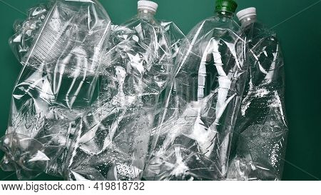 Heap Of Crumpled Transparent Pet Plastic Bottles Ready For Recycling. Used Bottles From Recyclable T
