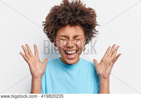 Overjoyed Ethnic Woman With Curly Bushy Hair Reacts Emotionally On Unexpected Gift Smiles Broadly Cl