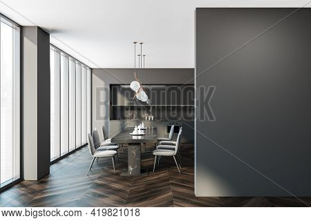 Empty Grey Wall Copy Space. Interior Of Modern Kitchen With Wooden Floor, Furniture, Table And Chair
