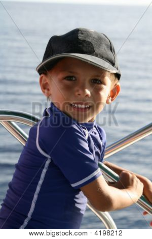 Boy In Front Of A Boat