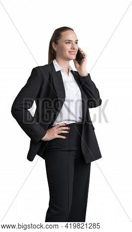 Business Woman In Black Suit With Smartphone Calling, Standing Pensive. Isolated On White Background