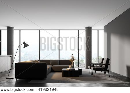 Interior Of Modern Living Room With Wooden Floor, Furniture, Table And Armchairs, Big Couch In The M