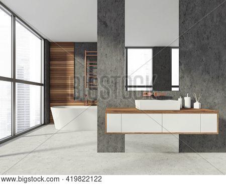 Modern Stylish Hotel Bathroom Interior, With Ceramic Bathtub And Sink With Mirror. Concrete Floor. W
