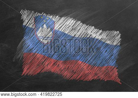 National Flag Of Slovenia Hand Drawn With Chalk On Blackboard. Flag Waving In Wind. One Of A Large S