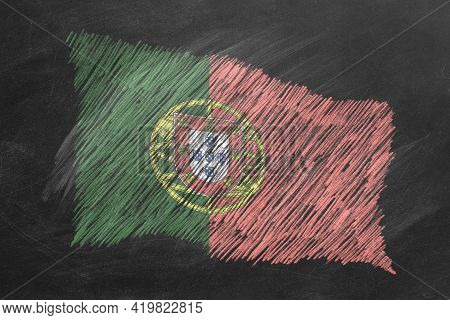 National Flag Of Portugal Hand Drawn With Chalk On Blackboard. Flag Waving In Wind. One Of A Large S