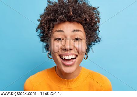 Close Up Portrait Of Dark Skinned Woman With Natural Curly Hair Clean Healthy Skin Smiles Broadly Ex