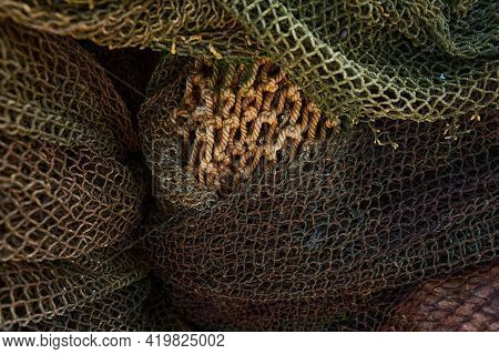 A Fishing Net Is A Net Used For Fishing. Nets Are Devices Made From Fibers Woven In A Grid-like Stru